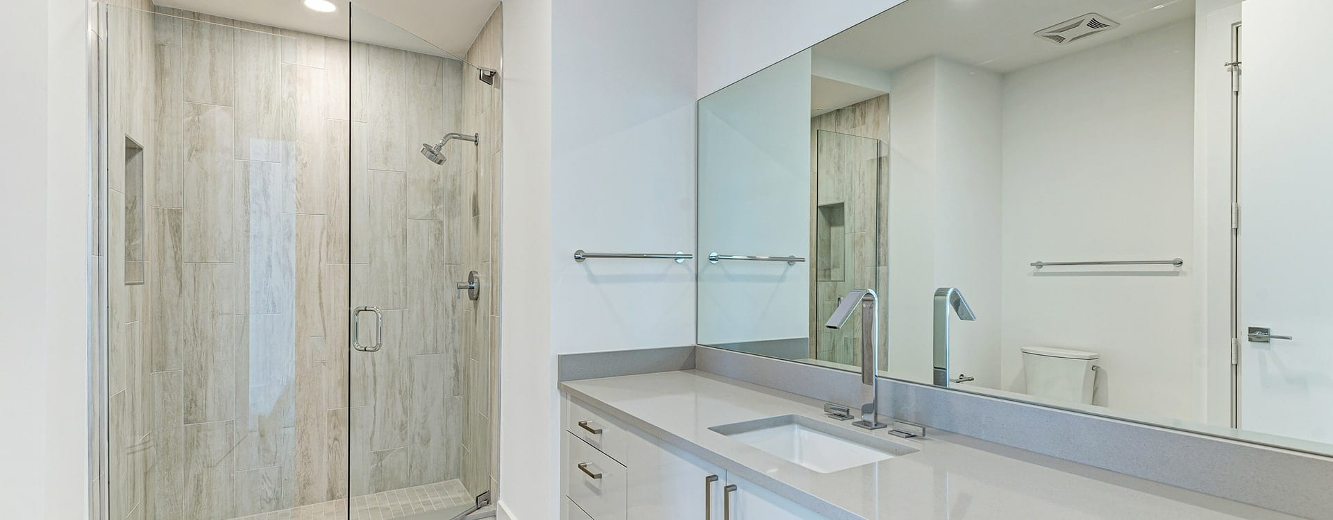 bathroom sink and shower at BLVD Sarasota Residence 1702